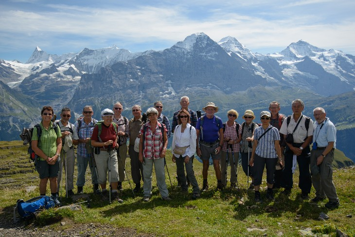 the group in front of the major peaks of the Bernese Oberland, Finsteraarhorn, Eiger, Mönch and Jungfrau